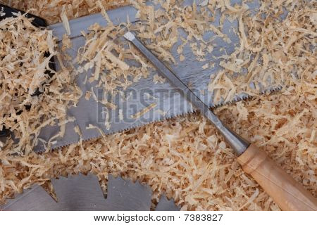 Wood Shavings, Table Saw Blade, Handsaw And Chisel