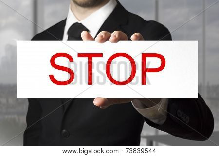 Businessman Holding Sign Stop