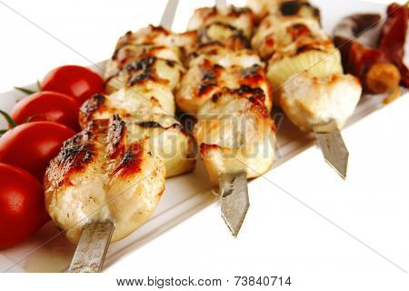 fresh roast chicken shish kebab on white platter