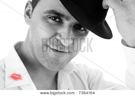 Seductive Man Greeting With His Hat And Shirt With Lipstick Mark