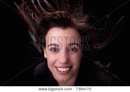 Young Woman From The Front, With Her Hair In The Wind