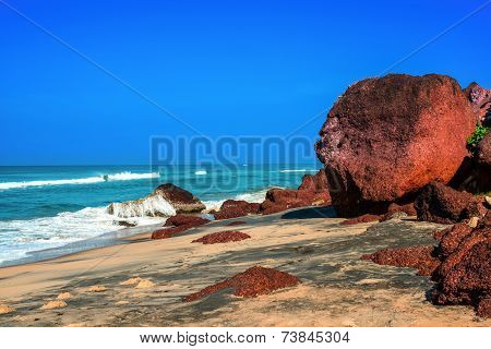 Beautiful Tropical Coast With Big Stones And Black Sand Of The Indian Ocean. Varkala, Kerala. India