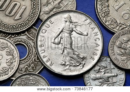 Coins of France. The sower designed by Oscar Roty depicted in the old five French franc coin.
