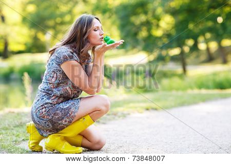 Beautiful Young Woman In Yellow Rain Boots With Rubber Toy Frog