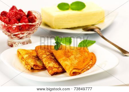 Pancakes with strawberries  and briquette butter