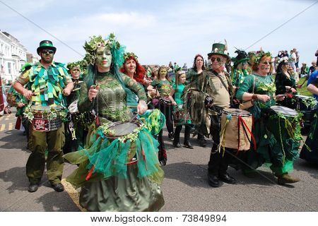 HASTINGS, ENGLAND - MAY 5, 2014: Drummers perform during the parade on the West Hill at the annual Jack In The Green festival. The traditional event marks the May Day public holiday in Britain.