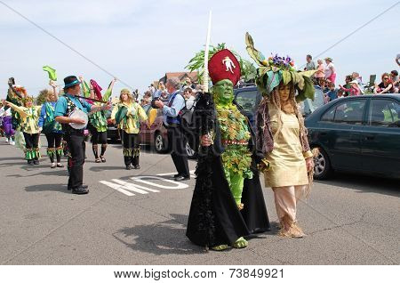 HASTINGS, ENGLAND - MAY 5, 2014: Costumed people take part in the parade on the West Hill during the annual Jack In The Green festival. The event marks the May Day public holiday.