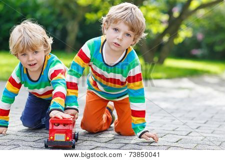 Two Siblings, Kid Boys Playing With Red School Bus