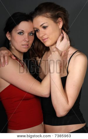 Two Young Lesbian Girl Friend On Gray Background