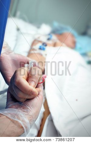 Hand In Glove Holding A Carefully Brush A Heavy Patient In Icu