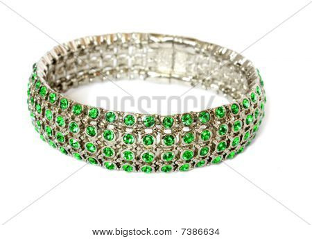 silver bracelet with green gem
