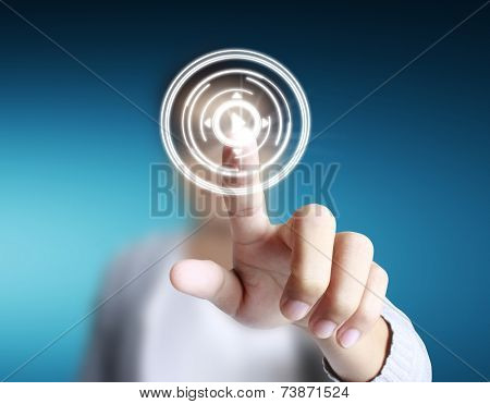 Finger pressing the touch screen display
