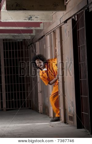 Young Man Breaking Out Of Prison