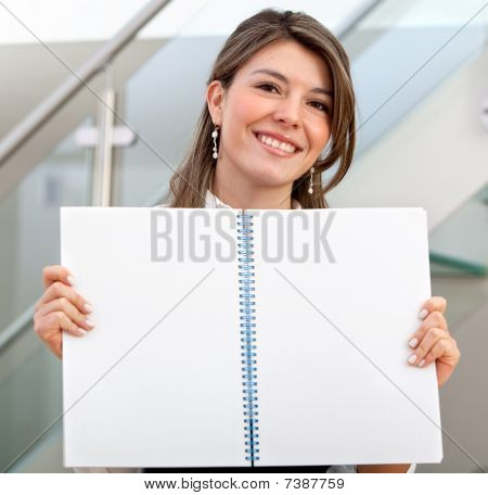 Woman Displaying A Notebook