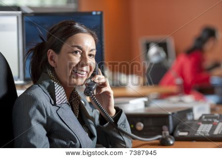Businesswoman Smiling And Talking On A Phone