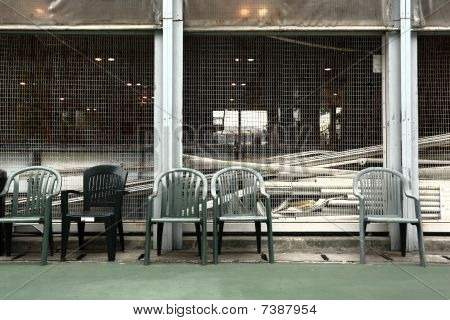 some old chairs in sport court