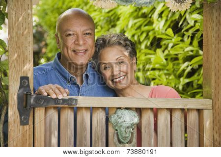 Senior African American couple looking over gate