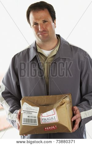 Man holding crushed package marked Fragile