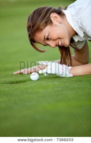 Golf Player Flicking The Ball