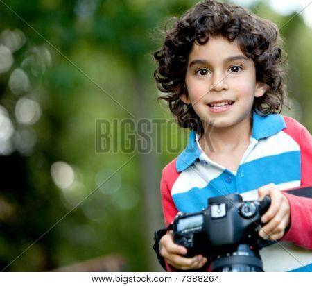 Beautiful Boy With A Camera