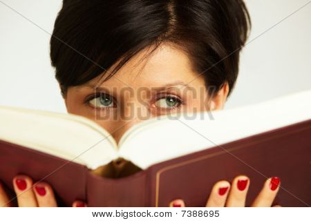 Pensive Woman With Book