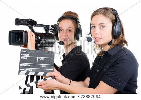 Two Pretty Young Women Work With A Video Camera