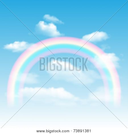 Background with rainbow, blue sky and clouds.