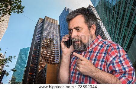 Businessman Talking On Mobile Phone In The Megalopolis