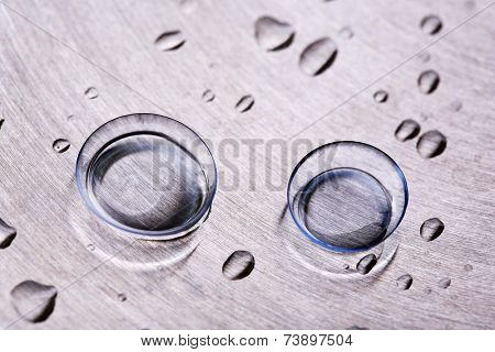 Contact lenses with water drops on bright background