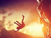 stock photo of dangerous situation  - Hiker free falling from the mountain - JPG