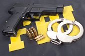 stock photo of ammo  - fbi concept with gun ammo and handcuffs - JPG