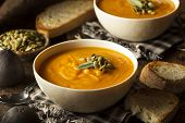 stock photo of butternut  - Homemade Autumn Butternut Squash Soup with Bread - JPG