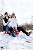 image of sled  - Mature couple sledding - JPG