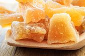 image of exotic_food  - Closeup candied crystallized ginger candy pieces on wooden spoon - JPG