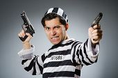 stock photo of inmate  - Funny prison inmate with gun - JPG