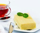 foto of briquette  - Briquette butter with a sprig of mint - JPG