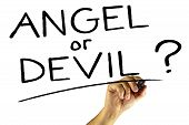 pic of hells angels  - A Hand with pencil writing ANGEL or DEVIL onto the screen - JPG