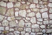 stock photo of stonewalled  - Ancient Turkish Beige Stonewall from Ottoman period for Background, shot at Topkapi Palace, Istanbul, Turkey