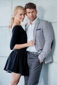 Photo of sweet young caucasian couple fashion shoot isolated on light gray wall background.