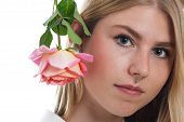 picture of nose piercing  - Portrait of a young blonde girl with nose piercing and rose - JPG