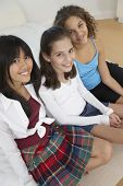 pic of pre-adolescents  - Three teenaged girls smiling - JPG