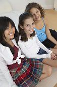 stock photo of pre-adolescent girl  - Three teenaged girls smiling - JPG