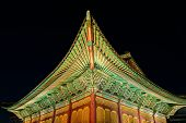 stock photo of gable-roof  - The gable roof of Deoksugung palace Seoul South Korea at night - JPG