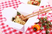 image of chinese checkers  - Chinese noodles and sticks in takeaway boxes on fabric background - JPG