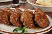image of meatloaf  - Meatloaf shaped into individual serving loaves on a serving platter - JPG