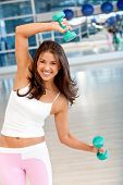 picture of weight-lifting  - Woman at the gym lifting a free - JPG
