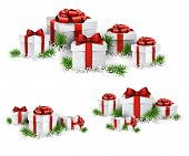 image of  realistic  - Christmas background with heaps of fir branches and realistic gift boxes - JPG