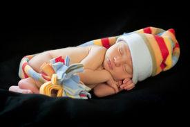 stock photo of sleeping baby  - Adorable sleeping newborn baby boy in hat - JPG