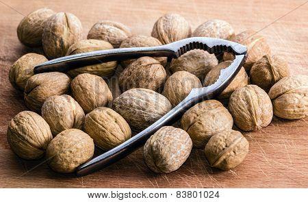 Walnuts And Nutcracker On A Cutting Board