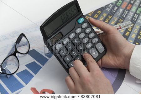 Young Businesswoman Calculating Financial Documents